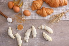 Composition with raw and baked  croissants Royalty Free Stock Photography