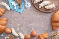 Composition with raw and baked  croissants Royalty Free Stock Images