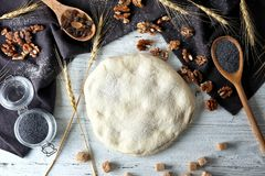 Composition with raw flaky dough. On table Stock Images