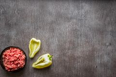 Composition of raw meat with vegetables and spice on wooden background. Top view. Copy space. Still life. Flat lay Stock Photo