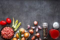 Composition of raw meat with vegetables and spice on wooden background Royalty Free Stock Photos