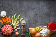 Composition of raw meat with vegetables and spice on wooden background. Top view. Copy space. Still life. Flat lay Stock Image