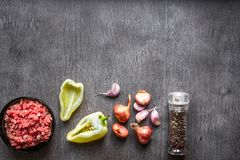 Composition of raw meat with vegetables and spice on wooden background. Top view. Copy space. Still life. Flat lay Royalty Free Stock Photography