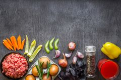 Composition of raw meat with vegetables and spice on wooden background. Top view. Copy space. Still life. Flat lay Royalty Free Stock Photo