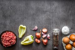 Composition of raw meat with vegetables and spice on wooden background. Top view. Copy space. Still life. Flat lay Royalty Free Stock Photos