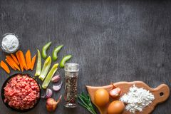Composition of raw meat with vegetables and spice on wooden background Stock Photo
