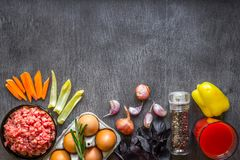 Composition of raw meat with vegetables and spice on wooden background Stock Image