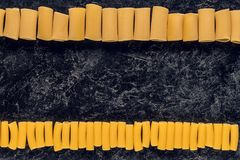 Composition of raw pasta. In rows stock photos