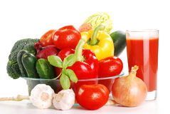 Composition with raw vegetables. Freshly washed vegetables and glass of juice isolated on white Royalty Free Stock Photography