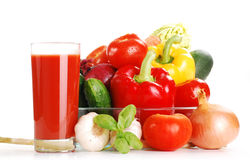 Composition with raw vegetables. Freshly washed vegetables and glass of juice isolated on white Stock Image