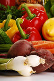 Composition with raw vegetables. Freshly washed raw vegetables: pepper carrot, beetroot, onion and lemon Stock Image