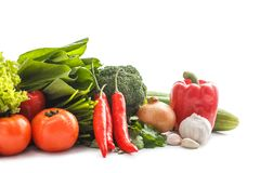 Composition with raw vegetables. Close up portrait of Composition with raw vegetables isolated on white Royalty Free Stock Images