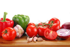 Composition with raw vegetables isolated on white. Composition with freshly washed raw vegetables on breadboard isolated on white Royalty Free Stock Photo