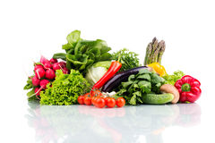 Composition with raw vegetables isolated on white. Close up Royalty Free Stock Photos