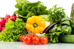 Composition with raw vegetables isolated on white. Close up Stock Image