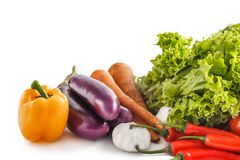 Composition with raw vegetables isolated on white. Close up portrait of Composition with raw vegetables isolated on white Royalty Free Stock Photography