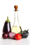 Composition with raw vegetables and olive oil Royalty Free Stock Image
