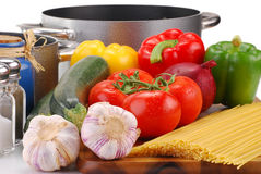 Composition with raw vegetables and spaghetti. On kitchen table Royalty Free Stock Images