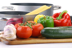 Composition with raw vegetables and spaghetti. On kitchen table Royalty Free Stock Photo