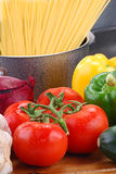 Composition with raw vegetables and spaghetti. On kitchen table Stock Photo