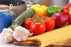 Composition with raw vegetables and spaghetti. On kitchen table Royalty Free Stock Photos