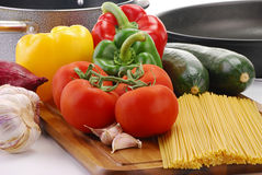 Composition with raw vegetables and spaghetti Stock Photography