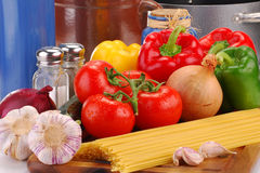 Composition with raw vegetables and spaghetti. On kitchen table Stock Photography