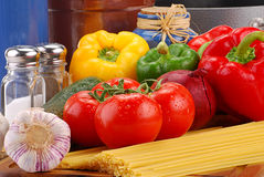 Composition with raw vegetables and spaghetti. On kitchen table Stock Photos