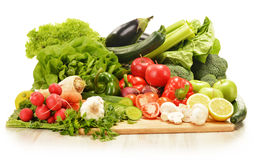Composition with raw vegetables  on white Stock Photography