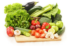 Composition with raw vegetables  on white. Background Royalty Free Stock Photography