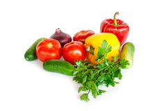 Composition with raw vegetables on white. Composition with multi-colored raw vegetables on white Royalty Free Stock Photo