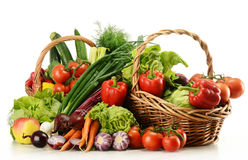 Composition with raw vegetables and wicker basket Royalty Free Stock Image