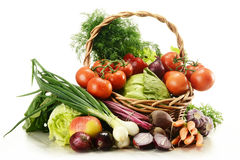 Composition with raw vegetables and wicker basket Stock Images