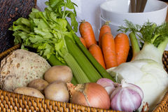 Raw vegetables and basket Stock Photos