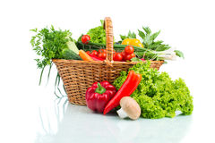 Composition with raw vegetables in wicker basket  on whi. Te close up Royalty Free Stock Photo