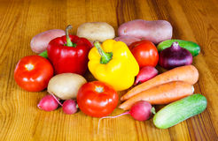 Composition with raw vegetables on wooden table Royalty Free Stock Images
