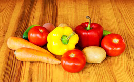 Composition with raw vegetables on wooden table Royalty Free Stock Photography