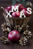 Composition with red apples. Christmas still life with apples and pine cones Royalty Free Stock Images