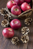 Composition with red apples. Christmas still life with apples and pine cones Stock Photo