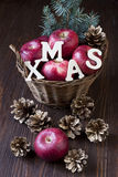 Composition with red apples. Christmas still life with apples and pine cones Stock Photos