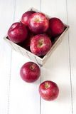 Composition with red apples. Christmas apples  on wooden table Royalty Free Stock Image