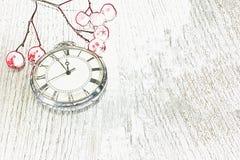 Christmas background. illustration, composition, red berry retro clock. Composition, red berry retro clock on a white wooden table. Christmas background Royalty Free Stock Photo