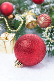 Composition with red Christmas ball and decorations, vertical Stock Photo