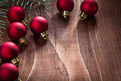 Composition of red christmas balls and branch of fir tree on old Royalty Free Stock Photo
