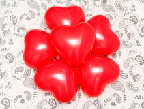Composition of Red Heart shaped balloons on a blanket Stock Images