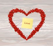 The composition of red hearts. Valentine`s Day. Yellow sheet of. Paper for notes. Sticker. Greeting card. Vector illustration on wooden background Royalty Free Stock Images