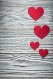 Composition of red hearts on wooden board Valentine cards Stock Photos