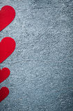 Composition of red paper hearts on metallic background Valentine Stock Image