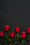 Composition of red roses on dark grey background. Romantic shabby chic decor. Top view. Love Concept. Valentines day. Roses with Gift box and pink ribbon on Royalty Free Stock Photos