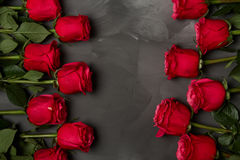 Composition of red roses on dark grey background. Romantic shabby chic decor. Top view. Love Concept. Valentines day. Roses with Gift box and pink ribbon on Royalty Free Stock Image